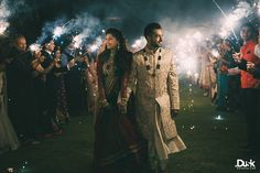 bride and groom entry, sparklers, night time, outdoor, farm house, fireworks