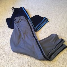 2 pairs of Marsh Landing running pants 2 Great pairs of running /work out pants. Drawstring top and zippers on both ankles. In like new condition. Charcoal grey pants with black stripes and navy blue pants with lighter blue stripes. They have front pockets on both sides. Both are in great condition, I cannot find any flaws. Very comfy. Buy both for $10 or each for $6. Marsh Landing Petites Pants Track Pants & Joggers