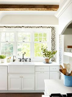 Small details like exposed beams and unique tile go a long way in this pretty kitchen. More decorating details: http://www.bhg.com/home-improvement/remodeling/architectural-details/add-delightful-details-around-your-home/?socsrc=bhgpin021813patterntile=9
