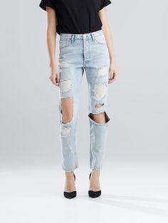 Hullete jeans med høy midje og løssittende passform. Blå