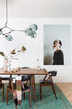 Loving this table and chairs and the glass shades of this light!