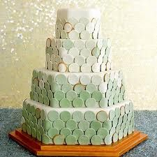 With this four-tier hexagonal confection, the Mahers conjure up the shimmery scales of sea creatures; roughly 500 fondant circles—in varying hues of pale green—are adhered to the cake with royal icing. Pretty Cakes, Beautiful Cakes, Amazing Cakes, Wedding Cake Inspiration, Wedding Ideas, Wedding Stuff, Dream Wedding, Ombre Cake, Colorful Cakes