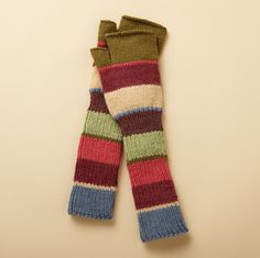 BLOOMSBURY FINGERLESS GLOVES--Warm and chic in the grand tradition of artists and artisans across the centuries, our colorful alpaca gloves keep hands cozy while leaving fingers free to create their next masterpiece. Imported. One size.