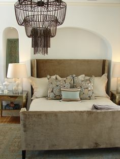 Suzie: Tracery Interiors - Mink brown velvet wingback bed, brown & blue pillows, mirrored ...
