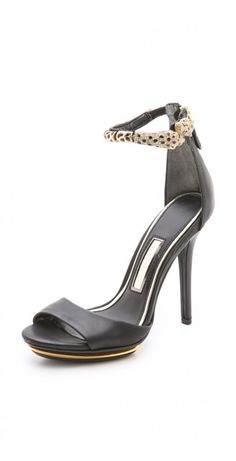 BRIANNA HIGH HEEL SANDALS $214.94 SPECIAL $50.00 YOU SAVE: 77% Rhinestone-speckled leopards curve around the ankle strap of these glamorous Boutique 9 sandals. Metallic trim traces the inset platform, and an exposed zip closes the back. Rubber sole.
