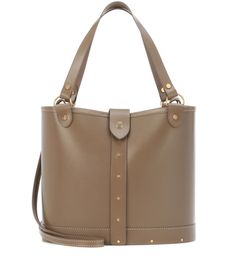 The Row - Pail leather and wood shoulder bag - The Row's Pail shoulder bag has a minimalist design that will stand the test of time and be on constant rotation season after season. It's been crafted in Italy from smooth khaki-brown leather and has a flat wooden base for a cool shift in texture. Nail-like hardware punctuates the piece with tough-luxe edge. Carry yours by the top handles or use the shoulder strap to go hands-free. seen @ www.mytheresa.com