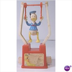 Acrobat toy I had goofy. My dad brought me Disney stuff when he had to travel to Orlando on business