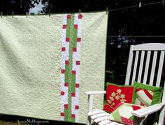 The back of my Christmas Ensemble quilt...and pillows out of the scraps.