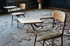 Holley High School (NY, USA) - Empty chairs, empty tables: Chunks of fallen plaster lie among traditional school desks marked by age. The building is still full of carcinogenic asbestos