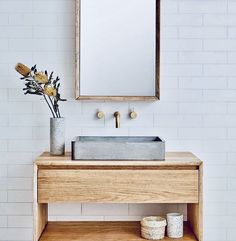 White tile wall, natural wood vanity with concrete floating sink, brass knobs, rectangular brass framed mirror. Minimalist Bathroom Furniture, Modern Bathroom, Small Bathroom, Master Bathroom, Bathroom Ideas, Neutral Bathroom, Bathroom Designs, Mirror Bathroom, Basement Bathroom