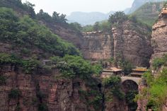 Temple in the mountains with a bridge in between the rocks