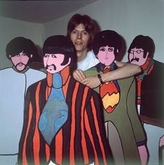 """1968: 21 year-old David Bowie next to a cut-out promo for """"Yellow Submarine"""" (Undated 1968 photo by Kenneth Pitt.)"""