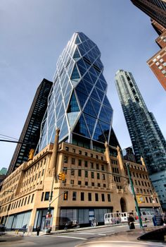 Hearst Tower – Achieves Highest Green Building Rating, LEED Platinum by norman-foster – architecture Classic Architecture, Facade Architecture, Amazing Architecture, Building Facade, Green Building, Building Design, Norman Foster, New York, Adaptive Reuse