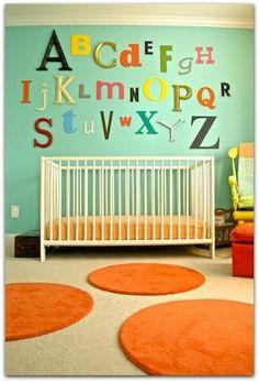 Holly over at Life as a Thrifter put together this eclectic room for daughter Ross with IKEA finds and thrift store treasures for a brightly finished space. Holly found all the letters for the alphabet wall online and paired them with a basic crib and rugs.