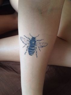 Honey bee on right forearm, more solid outlines than this though