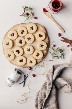 Plum linzer cookies. A sweet vanilla bean and orange almond linzer cookie with a simple plum jam. This delicious Christmas cookie will be gone in moments.