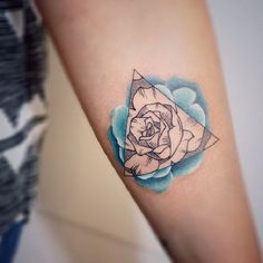A wonderful looking Triangle Glyph Tattoo with a floral touch to it. As you can see the flower in encased in the triangular shaped glyph symbol. It is small, minimalistic and pretty to look at.