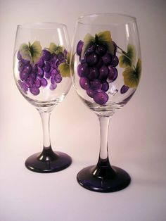 These hand painted large wine glasses would also make great water glasses. Clusters of purple grapes surround each glass with bases painted purple