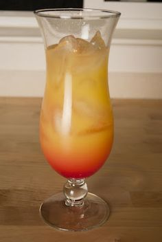 Malibu Sunrise:        2 shots Malibu Rum      2 shots orange juice      1/4 shot grenadine    In a hurricane glass, add ice 3/4 of the way up.  Add your Malibu rum and orange juice.  Stir it like a madman so that you mix everything up real good.  Pour your grenadine on top and enjoy!