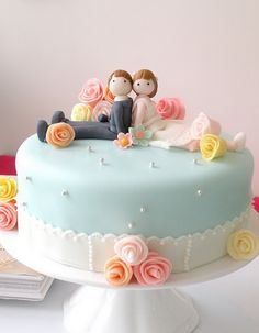 We could do this with a coral cake and navy ribbon