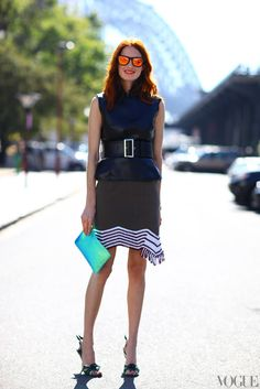 Taylor Tomasi Hill in J.W. Anderson skirt, Comme des Garçons clutch, and Prada shoes