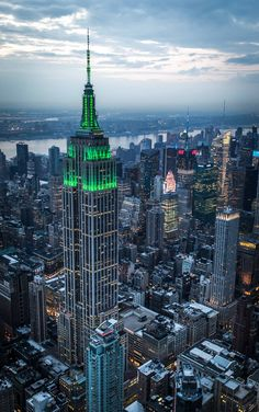 """May The Empire State Building's tower glows in green to honor the Robin Hood Foundation and its annual """"A Night for NYC"""" benefit. The foundation's mission is simple: to fight poverty in New York City. Photo by Aleksey Z. New York City, Vancouver, Toronto, New York Pictures, Chrysler Building, City Aesthetic, Canada, Concrete Jungle, Urban Landscape"""