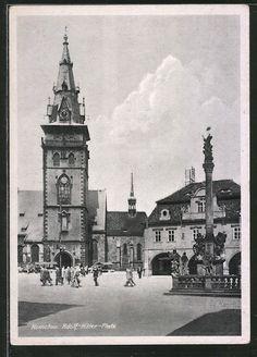 old postcard: AK Komotau / Chomutov, Adolf Hitler-Platz mit Passanten u. Pestsäule