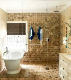 shower and freestanding tub behind shower door so when you splash around in the tub you dont have to mop up