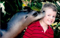 Benjy getting kissed by a seal