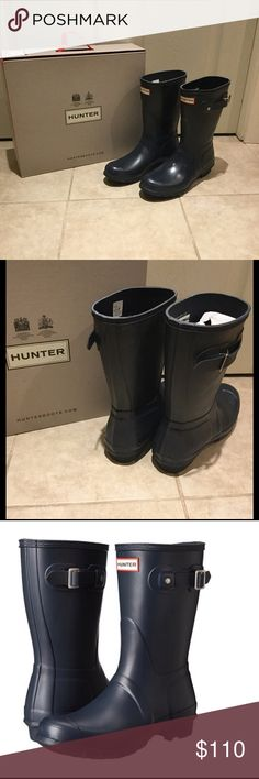 """NIB Hunter Original Short - Navy These rubber boots are styled with a brushed buckle strap detailing the top line.  Woven nylon lining lends extra warmth, and a cushioned footbed offers comfortable wear.  Lug sole.  Note:  high-quality natural rubber may release white marks, which can be wiped clean.  Measurements:  Heel: 1"""", Shaft: 10.25"""", Circumference: 14.5"""" Hunter Boots Shoes Winter & Rain Boots"""