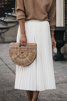 Effortless Summer Style | White Pleated Midi Skirt, Light Neutral Summer Sweater, Cult Gaia Bamboo Clutch