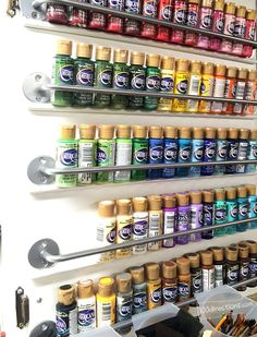 Organize craft paint on a cabinet door