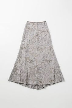 "Our pull-on Conner Skirt is fitted at the waist and flares at the hem with a slight train in back. It features an intricate, all-over hand-embroidered floral motif and is hand sewn in a double layer of 100% organic medium-weight cotton jersey. • Measures approximately 40"" at center front and 45"