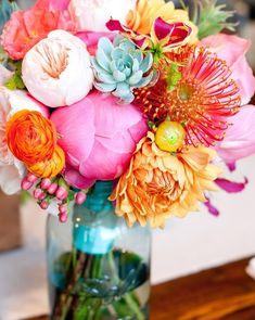 Beautiful bouquet with succulents, peonies, dahlias, ranunculus and pin cushion protea with a lovely bright blue. So colorful and so wonderful!