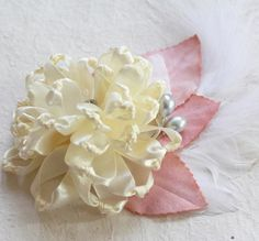Create this charming fabric flower for your DIY Wedding Accessories. Learn more.