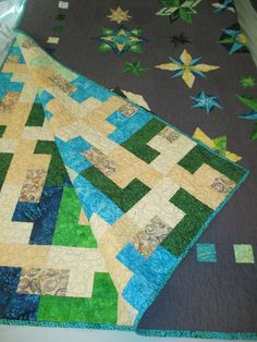 2014-2015. L & T wedding quilt.  Shows both sides of the quilt.  Made with Kona solid grey fabric and batiks.
