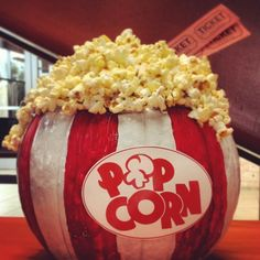 Pumpkin Decorating Contest idea- Popcorn theme. Rules: no carving, family friendly. Paint red and white stripes on pumpkin, pop plain popcorn, hot glue popcorn to top, print sign and hot glue to front, hot glue movie tickets - by Jenn Russell