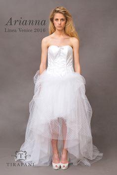 """L' abito da sposa Arianna, una nuvola di tulle e tulle a pois che sfrutta la """"sorpresa"""" del corto davanti. Il corpino ha una struttura d'alta sartoria, dietro stringhe con occhielli di Swarovski. Possibile anche in diverse varianti di colore.  #abitodasposa #Tirapani #TirapaniBridal #TirapaniRavenna #TirapaniSpose #weddingdress #bride #collezionesposa2016 #bridal #sposa2016"""