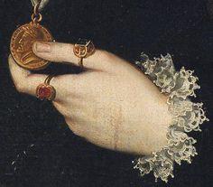 Archduchess Johanna von Austria detail left hand and medal of emperor Charles V  by Sofonisba Anguissola