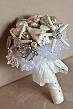 sea shells and brooches for a wedding bouquet