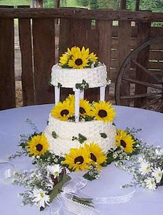 Make a cute sunflower and wicker basket designed cake for the centerpiece of the desert table :)