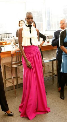 This look by Mimi Plange was the wild card of the collection. An intense hot-pink floor-length skirt with a black-and-white ruffled blouse whats not to love? Love Fashion, Fashion Outfits, Fashion Design, Chic Outfits, High Fashion, Hot Pink Skirt, Pink Pants, Dress For You, Dress Up