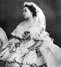 1858 photo of Princess Royal Victoria's wedding dress.  She was the oldest daughter of Queen Victoria.  She also looked just like her. Her oldest son became the last Kaiser of Germany, Wilhelm ll. He was pretty much the black sheep of the family when they would all get together for family bar b ques.