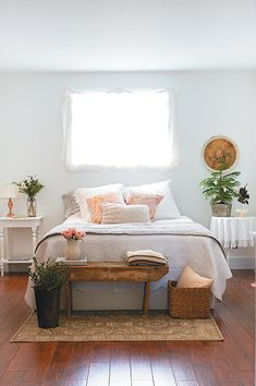 good mix of vintage furniture in country/cottage bedroom, walls are Benjamin Moore's Distant Grey ... light grey-white with blue tones, very calm and restful