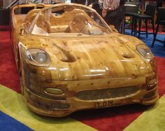 IT'S A MOTOR BOAT - not a car!!    Hand carved wooden Ferrari  Ferrari made entirely of wood, which was created by Italian artist Livio De Marchi (thus the LDM monogramming upfront). No, it's not a real car. Believe it or not, it gets more weird — it's a working MOTOR BOAT!