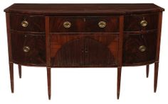 Coastal South Carolina Federal Figured Mahogany Sideboard -  Georgetown area, 1800-1815, figured mahogany veneers, five dovetailed drawers with yellow pine linings, one fitted with cellaret dividers, over two doors with faux tambour facing and open interior, original brasses, 39-1/2 x 69 x 28-3/4 in., Chicora Wood Plantation, Georgetown, South Carolina