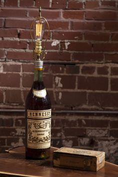 Vintage Hennessy Bottle Lamp This rare giant Hennessy bottle from France (early 1900's) was once the possesion of the historic Crown Candy Kitchen in St. Louis. It is unknown when is was made into a lamp, but, we all know Hennessy can light you up. It's vintage goodness... (http://www.themodbohemian.com/vintage-hennessy-bottle-lamp/)