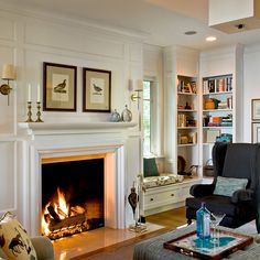 Love the little reading nook and built ins by the fire place. So cozy!