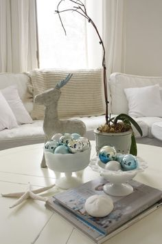 Christmas with a coastal flair. White and blue luminous ball ornaments, and beach treasures tossed in.