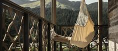 This is where you will feel at one with nature - and with yourself! Hotel Apartment, Apartments, One With Nature, Retro Chic, Outdoor Furniture, Outdoor Decor, Best Hotels, Hammock, Switzerland